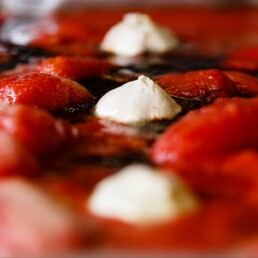 Close-up of ingredients for pizza base tomato sauce in a roasting tray