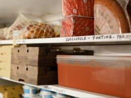 Ingredients stacked on the shelves in the Pompeii Pizza cold room