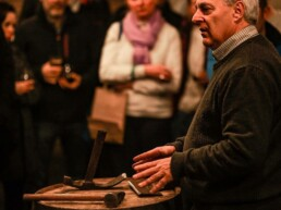 Audience watches as Master Cooper Ger Buckley presents coopering tools at pizza pairing event