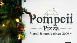 Pompeii Pizza gift vouchers surrounded by Christmas lights