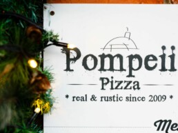 Pompeii Pizza gift voucher surrounded by christmas lights